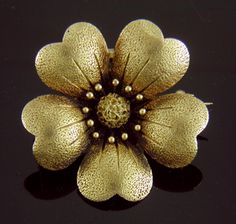 Golden Anemone!  A beautifully crafted brooch of an anemone with richly detailed petals, stamens and center.  In the late Victorian era jewels realistically depicting flora and fauna were the fashion.  A golden garden and menagerie was created to celebrate a wearer's love of nature and beauty.  Crafted in 14kt gold, circa 1900.