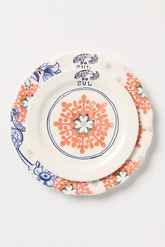 $10-18 - Do Sul Dinnerware  STYLE # 24150815.  Blue Motif  DETAILS  Blue sprigs, floral-centered coral medallions and tiny, illustrated fish, inspired by Brazilian dishes