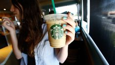 A patron holds an iced beverage at a Starbucks coffee store in Pasadena, California July REUTERS/Mario Anzuoni/File Photo Hot Coffee, Iced Coffee, Coffee Cups, Coffee Life, Starbucks Coffee, Iced Tea, Starbucks Advertising, Basic Image, National Coffee Day