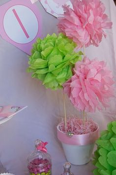 tissue paper poof balls on a stick! Pop them in a glass vase filled with peanuts, tie a ribbon on it.