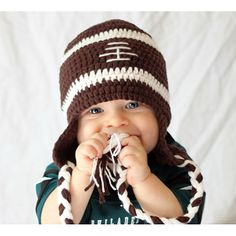 Score a touchdown this perfect gift for your little sports fan. This football design cap is crafted with deep brown 'pigskin' and white stitches, accented with two dual colored tassels. Perfect for a chilly day at the game or a wintry tailgate party.