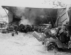 Burning jeeps from the 104th Inf Rgt, 26th Inf Div after a German indirect fire attack at Wiltz,.jpg