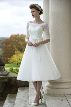 tb-pippa  Tea length dress with full organza skirt, lace bodice with sleeve and delicate lace trimmed neck line