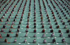 Schoolchildren attend a yoga session during a camp in the western Indian city of Ahmedabad on January 9, 2012.