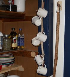 "Mug holder made from birch branch sawed flat and attached to wall. Smaller branches cut down just long enough to be ""hooks. Natural Cups, Mug Holder, Birch Branches, Natural Earth, Diy Wall, Wood Crafts, Ladder Decor, Cup Hooks, Rustic"