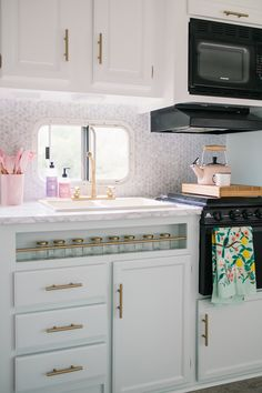 DIY RV makeover in white, pink, mint green and gold with modern & vintage glam accents. Vintage Glam Looks, Ikea Table, Apartment Hacks, Diy Rv, Cupboard Handles, Camper Makeover, Trailer Remodel, Vinyl Plank Flooring, Diy Camper