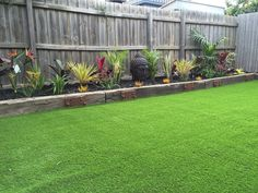Tropical garden bed with synthetic turf