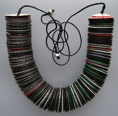 Craig McIntosh, New Zealand: 'Momento' Beer bottle caps, waxed cord, sterling