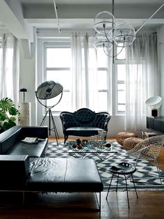 living divani ile sectional sofa, modern victorian settee, black leather, Oluce ceiling lamp, Indian rug, B&B Italia - alanda table, tractor stool