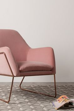 Soft curves and a sleek contemporary shape are integral to the charm of our Frame armchair. Slender yet strong, its elegant rose gold tone frame supports the back and arms, seamlessly transitioning into the legs of the chair, giving an industrial feel to every living room.