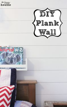 Like this alot -- cheap and easy.  DIY Plank Wall {Project One in the Boys' Bedroom} - The Happy Housie