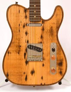 """By Walla Walla Guitar Company""""NAILED IT!"""" Maverick Outlaw-XStratocaster Electric GuitarReclaimed Vintage Wood over Full Chamber BodyMODEL: #70309FEATHER WEIGHT!!!Most WWGC guitars weigh in around 6-7 pounds rather than others at 7-9 pounds.AVAILABLE FOR LOCAL PICKUP!INCLUDES: Hard Case (as shown)..."""