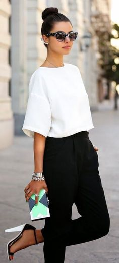 Black cropped trousers and loose white shirt