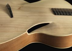 Picture an acoustic guitar and what do you see? The classical guitar with its wooden body and circular sound-hole, right? That guitar was designed sometime in the by Antonio de Torres, and … Guitar Chords, Music Guitar, Guitar Amp, Cool Guitar, Guitar Body, Ukulele, Custom Acoustic Guitars, Custom Guitars, Unique Guitars