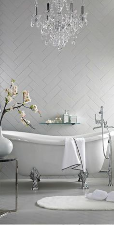 Between the beautiful tile, the chandelier, and the soaking tub, what more do you need?
