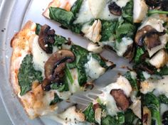 Fresh spinach & local Yamhill mushroom grilled pizza from @Pulehu Pizza  #thincrust #grilledpizza #pulehupizzapdx #pdxeats #eatfresh #eatlocal