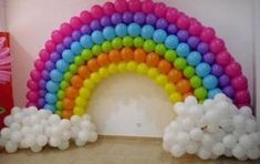 there's a bright balloon arch sculpture. We love the fluffy balloon clouds Rainbow Parties, Rainbow Birthday Party, Rainbow Theme, Unicorn Birthday Parties, Unicorn Party, Rainbow Dance, Kids Party Themes, Birthday Party Decorations, Party Ideas