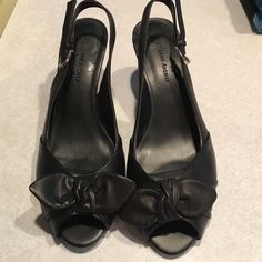 Black heels with tiny bow Black heels with tiny bow at toe. Great condition only used a few times. Size 7.5 Etienne Aigner Shoes Heels