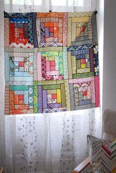 Scrappy Log Cabin Quilt Top by berlinquilter, via Flickr. I like how this quilter used variations of only two colors in each log cabin block, then used red for each center square.
