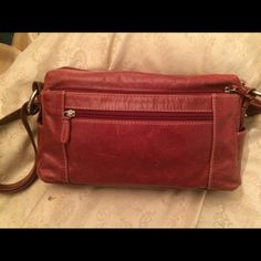 Red leather Giani Bernini Amazingly soft leather holds all the compartments you could ever need! I have loved this bag! There is a small bit of wear on one strap as shown in the picture. That's all this beauty still has its key fob! Giani Bernini Bags