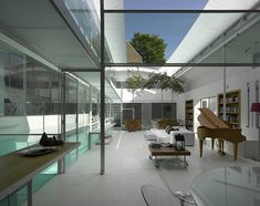 A vertically rising glass wall and a curved opening glass roof.
