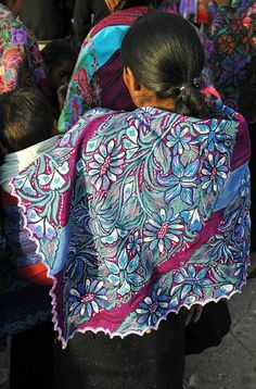 A Maya woman wears a beautiful embroidered cape at the festival of San Sebastian in Zinacantan Chiapas Mexico