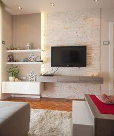 Contemporary Living Room Featuring A Stone Accent Wall