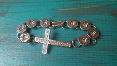 Bullet casing cross bracelet Hey, I found this really awesome Etsy shop at https://www.etsy.com/shop/ShotsFiredDesigns