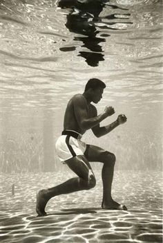 Muhammad Ali by Flip Schulke (love this photo. Ali didn't know how to swim!)