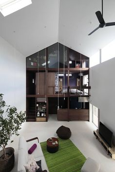 Ondesign's 'House with Empty Lot' in Japan is designed for a couple with 'his' and 'her' sides, joined by a large central living space and with an air of a Doll's House: http://www.archello.com/en/project/house-empty-lot #Architecture #Interior #design