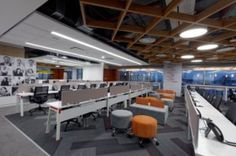 The spatial layout majorly has a central core with all the closed spaces with the workstations enveloping the core in an L shaped profile, with the reading lounge and leadership area in the point of conjunction of the arms being an open office, the hierarchy is reflected in design elements. The ceiling and flooring changes rhythmically in the open office to demarcate the different spaces and hierarchy.