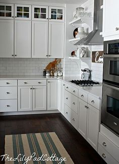 white kitchen cabinets   like the hardware   dark floors