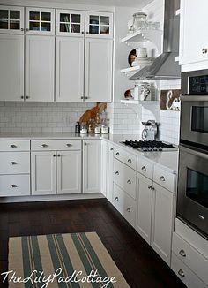 white kitchen cabinets   like the hardware   dark floors