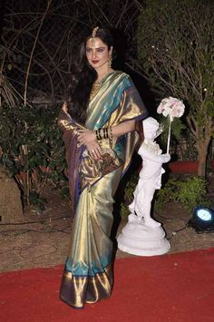 Rekha in Showstopping Gold, Turquoise and Royal Blue Saree