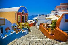 Greece Santorini - I love the cobble steps that lead down to the beach. Stunning.