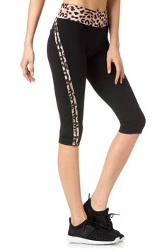 Snug fitting crop leggings are topped with a wide cheetah print waistband and trim down side seams.  On The Prowl Leggings by Miss Me. Clothing - Activewear California