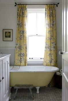 Claw foot tub, bottom painted; curtains