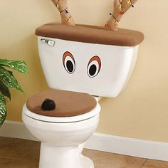 Reindeer Toilet Seat Cover And Antlers...not sure I have the motivation for it this year, but I think this is going to be on the elf antics list for 2012.