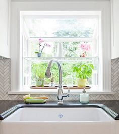 One of the best ways to decorate your garden window is with plants. With the added light garden windows create, it's the perfect spot for your indoor plants to thrive. Kitchen Garden Window, Garden Windows, Kitchen Decor, Kitchen Windows, Bay Windows, Kitchen Ideas, Diy Kitchen, Windows Image, Awesome Kitchen
