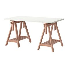 IKEA FINNVARD/LINNMON Table White/beech 150x75 cm You can choose a flat or tilted table top, which is good for writing, painting or drawing, by adjusting the trestle.
