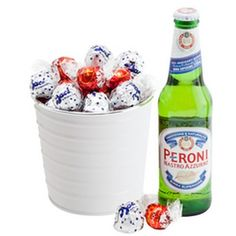 """A drop of Peroni and a bunch of chocolates are just the way to finish the day. Whether you`re celebrating, saying thank you or just sending some sweet wishes, they`ll be enjoyed all the same! Includes: 1 x Peroni Beer, 10 x Milk Chocolate Lindt Balls, 10 x Baci chocolate """"kisses"""", Keepsake white bucket, Complimentary gift wrapping and gift card."""