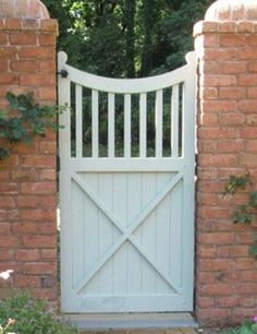 """- Sophistication coexists with privacy when a square picket top, board walk gate provides an entranceway in a brick wall. The scallop top is accented by a board bottom panel with a decorative """"X"""" brace. Easily crafted from wood or solid cellular vinyl. Wooden Garden Gate, Garden Gates And Fencing, Wooden Gates, Side Gates, Front Gates, Entrance Gates, Garden Entrance, Brick Fence, Front Yard Fence"""