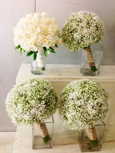 I like the idea of baby's breath bouquets for the bride'smaids to compliment a white rose bouquet for the bride