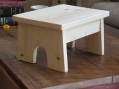 Something not so Rustic....:) This stool is all hand made using spruce wood. All edges have been softened doing away with any sharp corners or edges and ready for use. Fastened with glue and concealed pocket screws. Natural finish with a clear sealer Measures about 12 long, 9 wide and stand 6.75 high