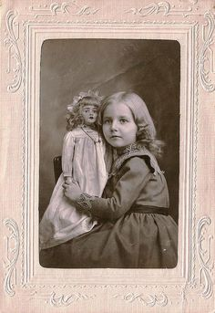 Beautiful antique Victorian cabinet card photo of a pretty little girl and her big doll.