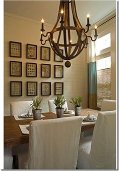 Like the white slip covers - then can make a big statement with an oriental rug and an awesome dining table. Good to have a great lighting fixture too