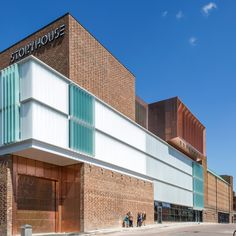 Bennetts Associates has renovated a 1930s cinema and added a brick, frosted-glass and copper extension to create this cultural centre in Chester, England