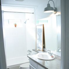 A dated brown bathroom fantastically refinished!  (Featured on Apartment Therapy)