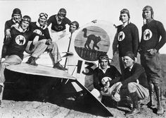 """The '13 Black Cats', Burdette Airport, Los Angeles in the 1920's. Photo: The Denny Archives - These daring fliers included Bon MacDougall (founder) Reginald Denny (standing second from the right), """"Spider"""" Matlock, """"Fronty"""" Nichols and Hollywood stunt pilot Art Gobel. Goebel later flew to fame as pilot of the """"Travel Air"""" Monoplane the """"Woolaroc"""", to win the 1927 Dole Race, Oakland, California, to Wheeler Field, Hawaii."""
