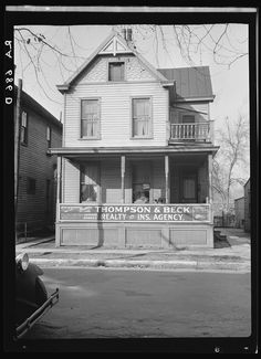 """""""House in Cincinnati showing its conversion into businnesses and blight."""" Taken December 1935."""